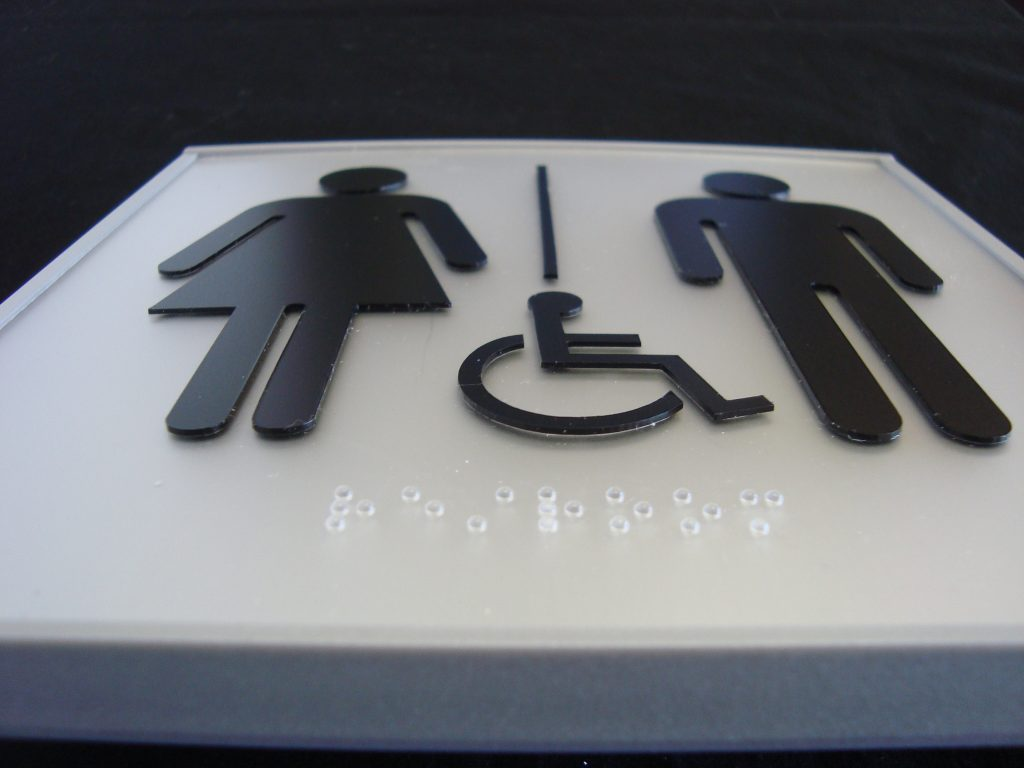VSF150-6PWB Flat Unisex Washroom Sign with ADA and braille close up M F HC